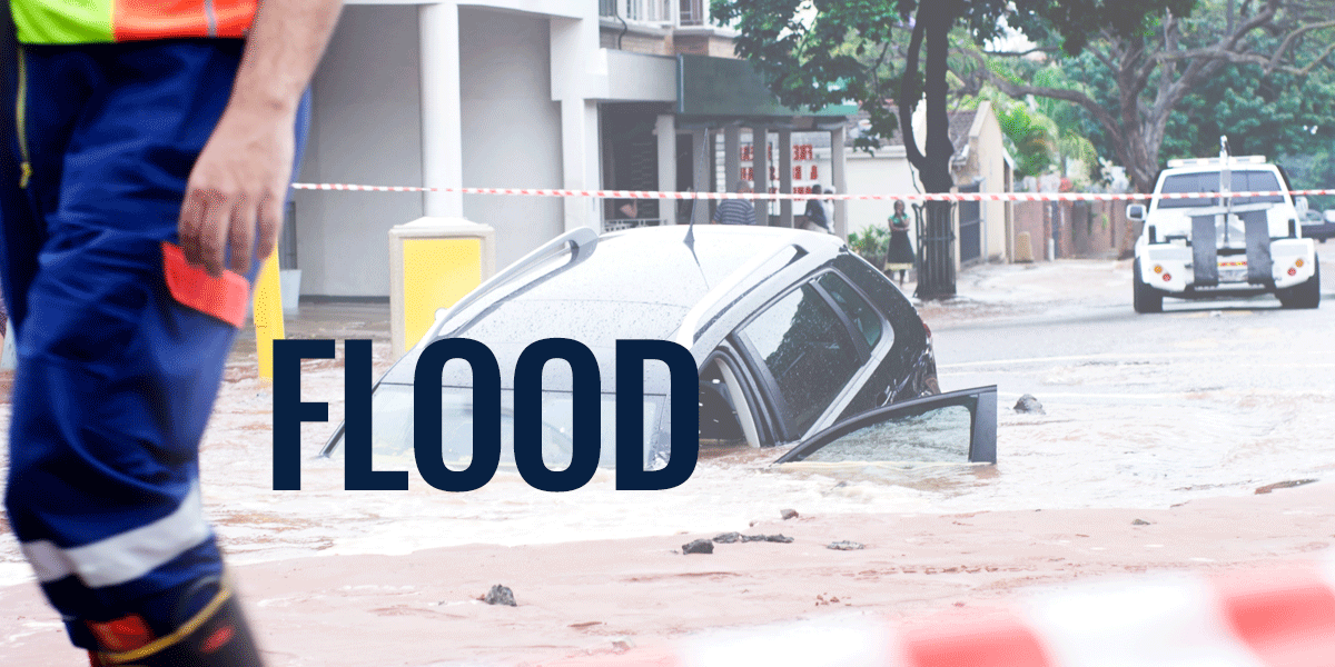 flooded street with car sinking