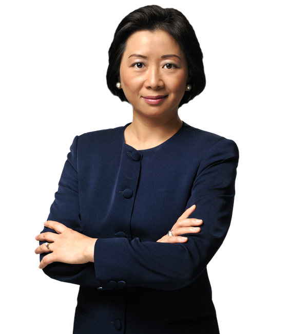 Happy looking lady in a dark blue suit with arms folded
